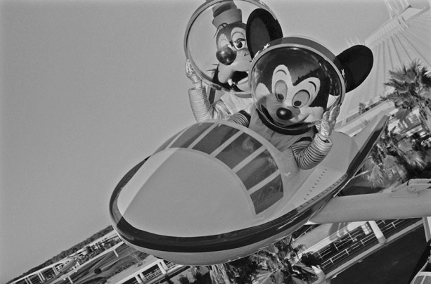 Caption This: Mickey & Goofy Blast Off On Star Jets at Magic Kingdom Park