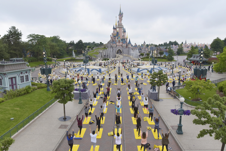 Thousands Celebrate International Yoga Day at Iconic Disney Parks Locations