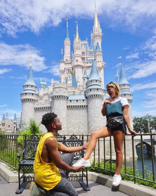 Olivia Holt and Aubrey Joseph in front of Cinderella Castle at Walt Disney World Resort