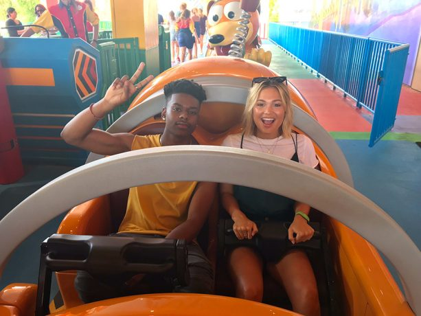 Olivia Holt and Aubrey Joseph riding Slinky Dog Dash at Toy Story Land at Walt Disney World Resort