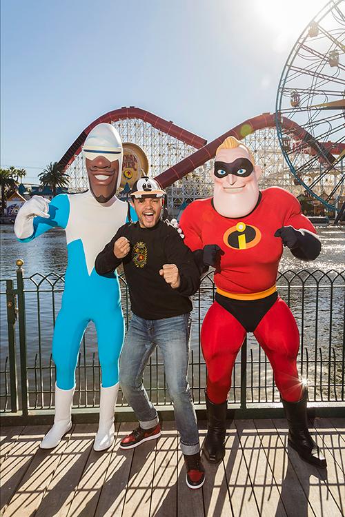 TV Host Trevor Noah Encounters Frozone and Mr. Incredible at Pixar Pier in Disney California AdventurePark