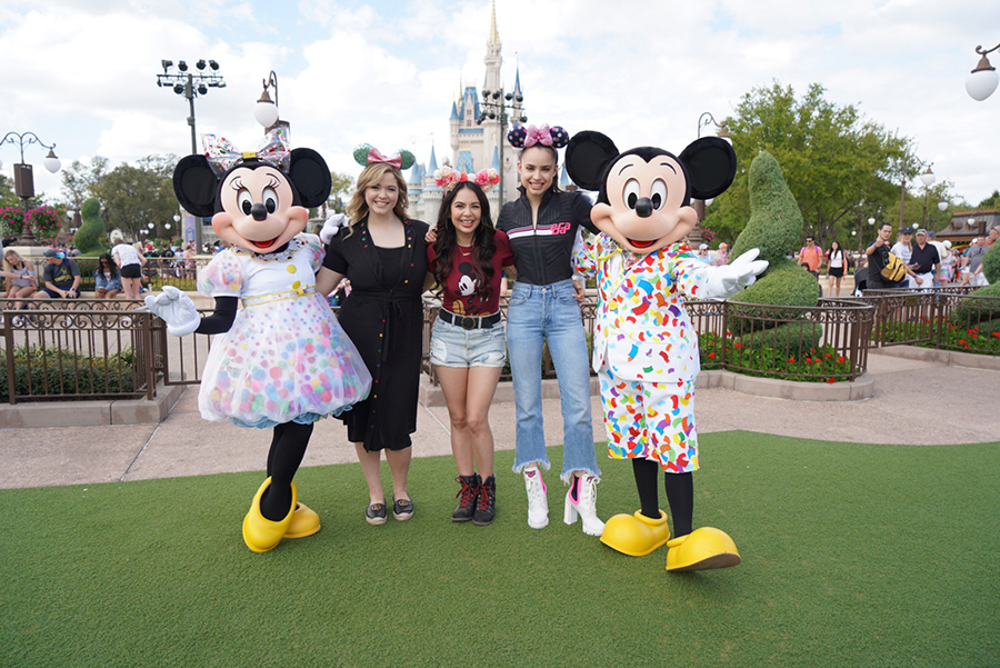 Sasha Pieterse, Janel Parrish, and Sofia Carson from the cast of Pretty Little Liars at the entrance to Magic Kingdom Park