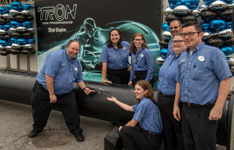 TRON attraction construction milestone at Magic Kingdom park - cast members sign name on first steel support columns for the new attraction