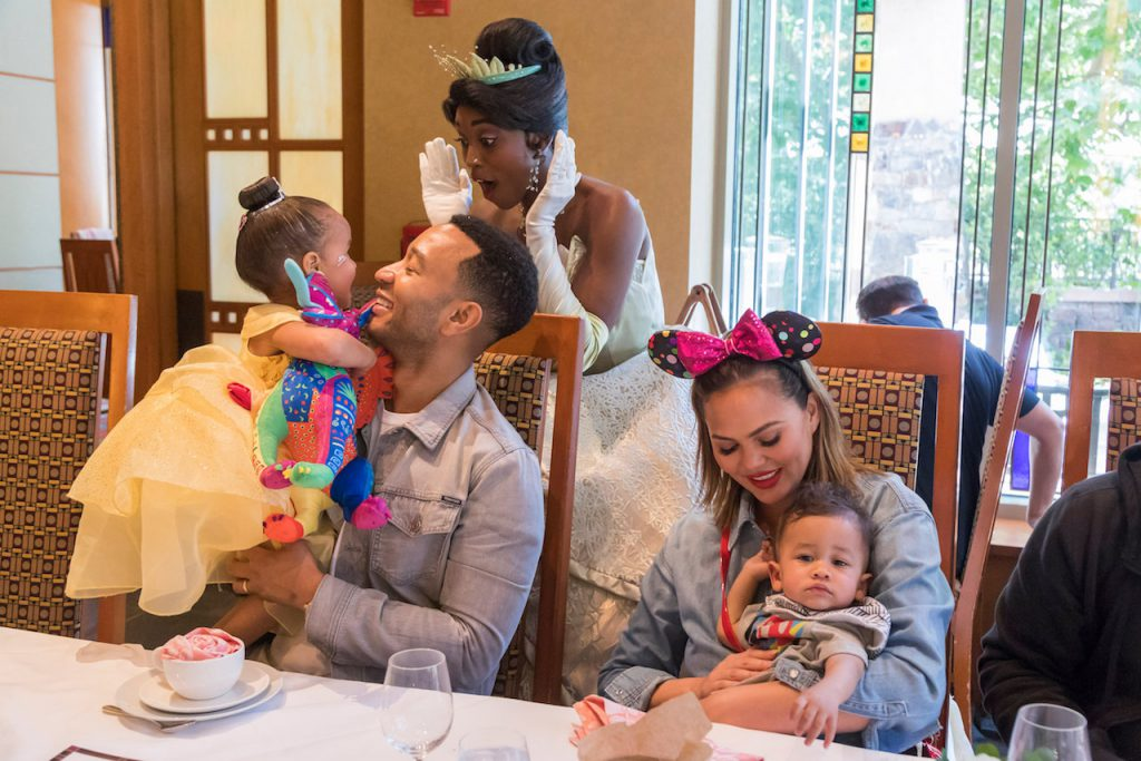 John Legend, Chrissy Teigen, their daughter Luna and son Miles share a magical moment with Princess Tiana during the new Disney Princess Breakfast Adventures at Disney's Grand Californian Hotel