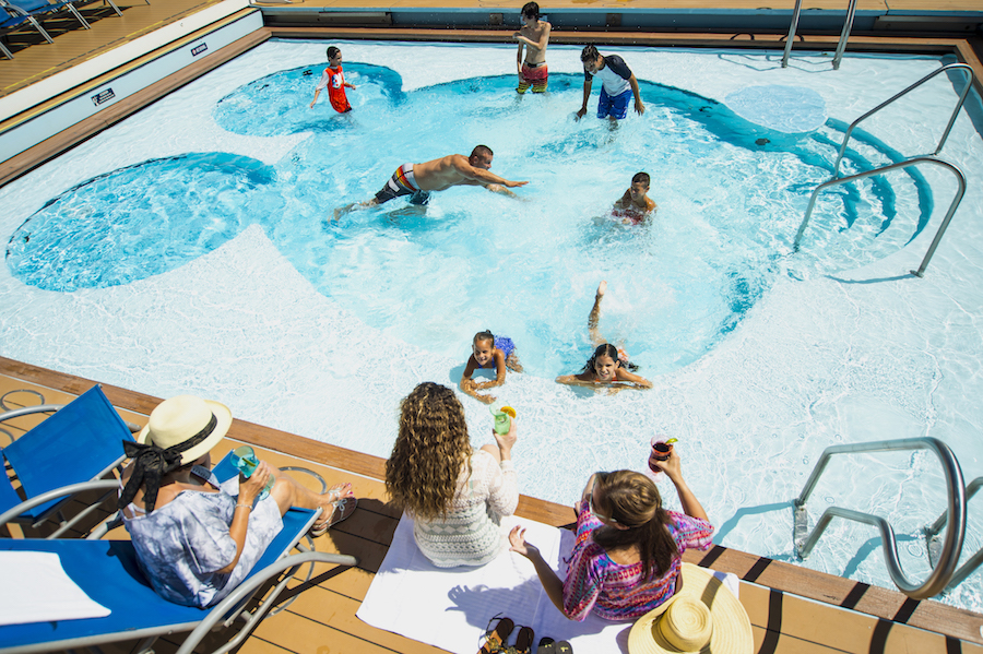 Kids swimming in the Mickey Pool on Disney Cruise Line