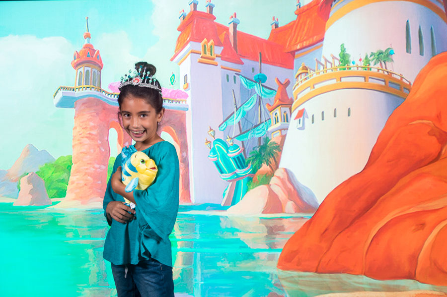 Prince Eric's Castle virtual backdrop at the Disney PhotoPass Studio at Disney Springs.