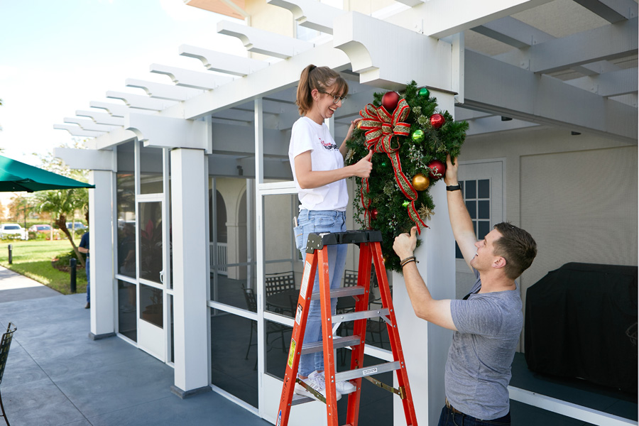 Walt Disney World cast members decorate Orlando Fisher House for the holidays