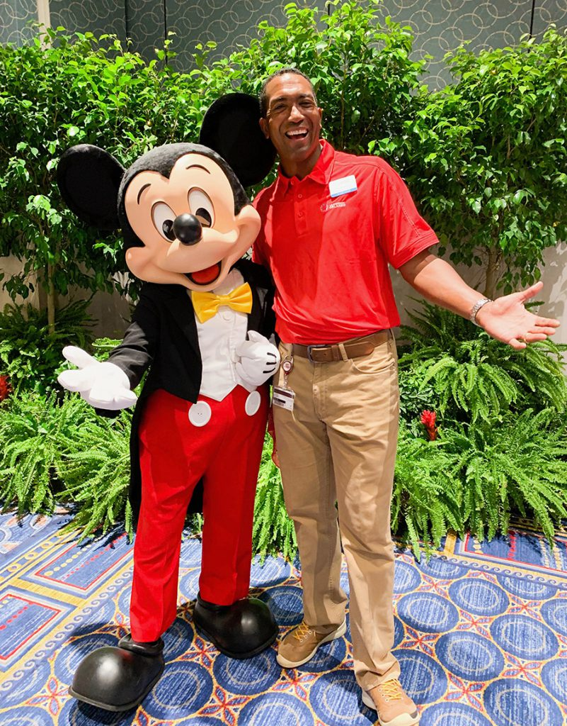 Leonard Spencer with Mickey Mouse